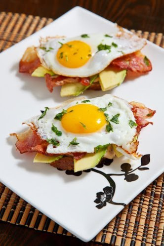 Poached egg on toast with chipotle, mayo, bacon and avacado